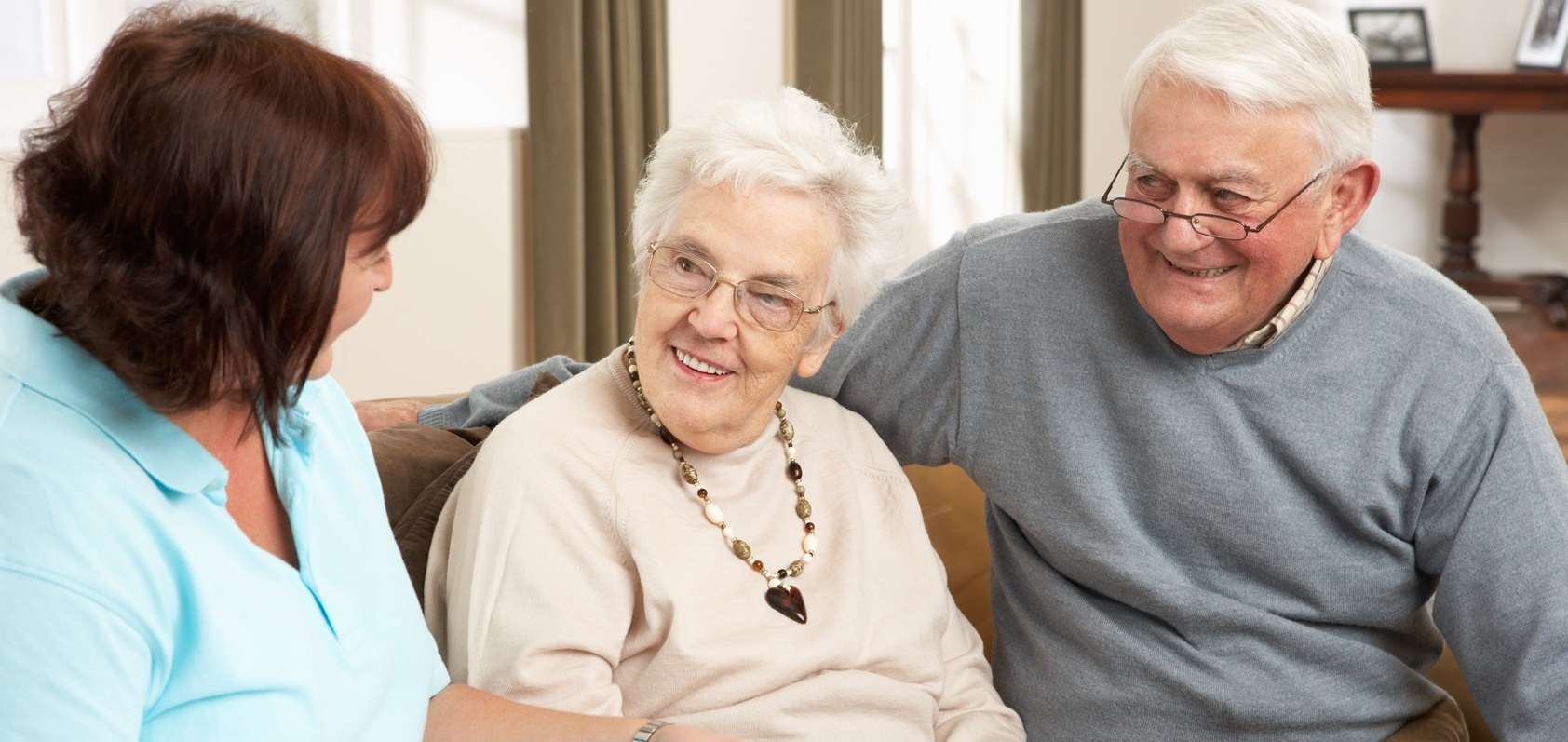 Senior Couple In Discussion With Home Health Aide